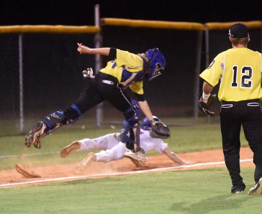 Mountain Home catcher Garrett Steelman runs down a Maumelle baserunner on Friday night at the state tournament in Conway.