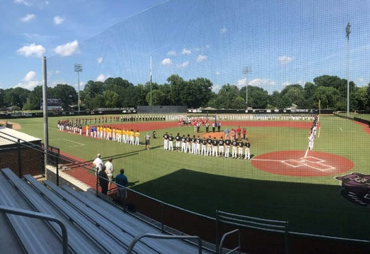 Teams participating in the Senior American Legion State Tournament gather for opening ceremonies on Friday at Bear Stadium in Conway.