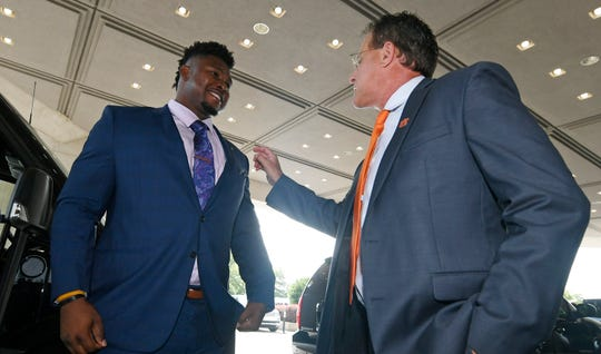 Auburn coach Gus Malzahn fixes the lapel of Prince Tega Wanogho.Auburn football SEC Media Day on Thursday, July 18, 2019 in Hoover, Ala.Todd Van Emst/AU Athletics