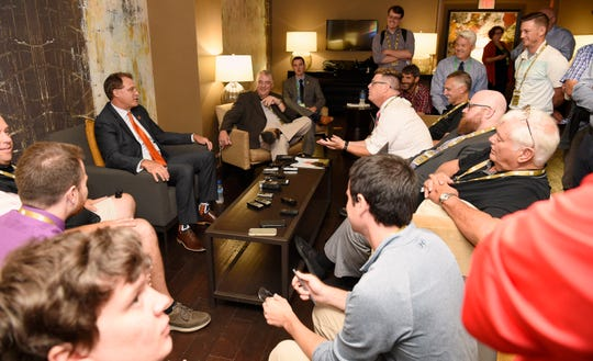 Auburn coach Gus Malzahn talks to local beat reporters at SEC Media Days on Thursday, July 18, 2019 in Hoover, Ala.