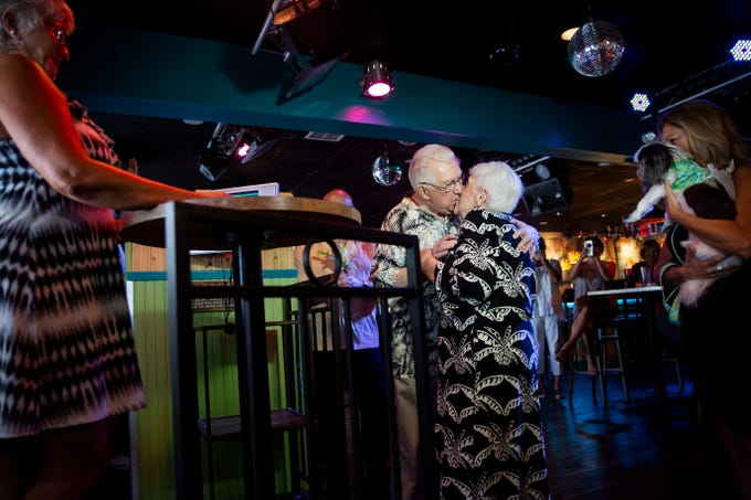 Harry and Evelyn Balzert kiss during their wedding at Bambusa Bar & Grill in Naples on Saturday, July 20, 2019. Harry and Evelyn, both veterans of the Korean War, have been together for almost a decade and decided to tie the knot at Bambusa, which hosts one of the many karaoke nights they attend weekly. In their vows, Harry promised to continue cooking for Evelyn, and she promised to continue chauffeuring him to karaoke.