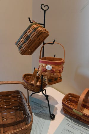 Baskets for sale in the silent auction during the Dave Longaberger Legacy Dinner in July 2019 at The Virtues Golf Club, formerly Longaberger Golf Club.