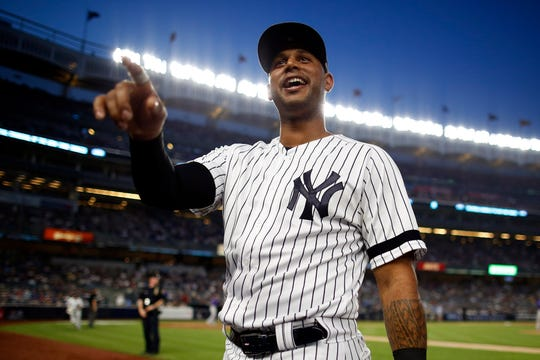 Jul 19, 2019; Bronx, NY, USA; New York Yankees center fielder Aaron Hicks (31) talks with fans against the Colorado Rockies during the fourth inning at Yankee Stadium.
