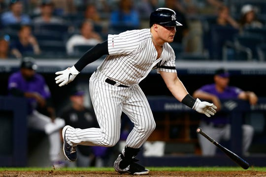 Jul 19, 2019; Bronx, NY, USA; New York Yankees first baseman Luke Voit (45) hits a single against the Colorado Rockies during the fifth inning at Yankee Stadium.