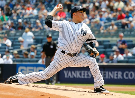 Jul 20, 2019; Bronx, NY, USA New York Yankees starting pitcher Masahiro Tanaka (19) pitches against the Colorado Rockies during the first inning at Yankee Stadium.