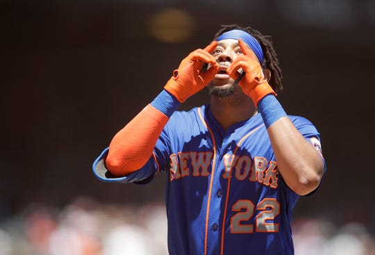 New York Mets' Dominic Smith celebrates after hitting a homerun off San Francisco Giants' Jeff Samardzija in the second inning of a baseball game Saturday, July 20, 2019, in San Francisco. (AP Photo/Ben Margot)
