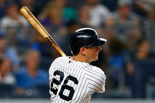 Jul 19, 2019; Bronx, NY, USA; New York Yankees second baseman DJ LeMahieu (26) hits an RBI single against the Colorado Rockies during the fourth inning at Yankee Stadium.