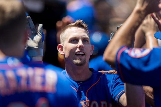 Jul 20, 2019; San Francisco, CA, USA; New York Mets right fielder Jeff McNeil (6) celebrates with teammates in the dugout after hitting a two run home run against the San Francisco Giants in the fifth inning at Oracle Park. Mandatory Credit: John Hefti-USA TODAY Sports