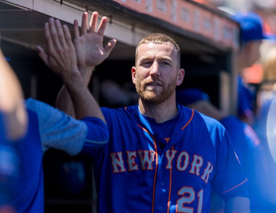 Jul 20, 2019; San Francisco, CA, USA; New York Mets third baseman Todd Frazier (21) celebrates in the dugout after scoring against the San Francisco Giants in the fourth inning at Oracle Park. Mandatory Credit: John Hefti-USA TODAY Sports
