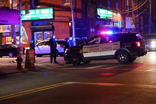 Police on Market Street at Mill Street in Paterson, NJ around 1:45 a.m. on July 20, 2019. The police responded to multiple scenes of multiple shootings Saturday morning.
