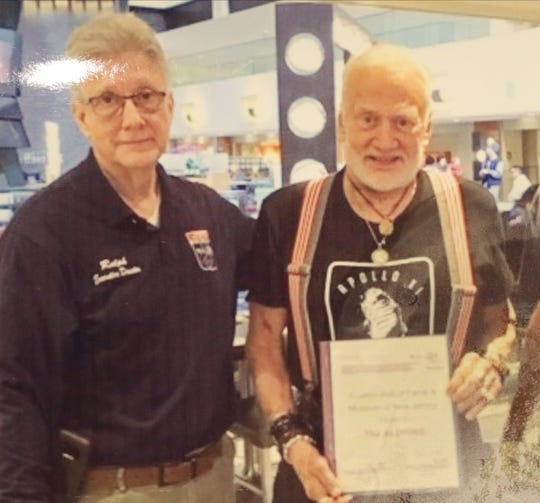 A photo of Ralph Villecca, Director of the Aviation Hall of Fame and Museum of NJ and Buzz Aldrin taken at the museum. Villecca spoke as Montclair hosted an Apollo 11 commemoration event on July 20, 2019 to celebrate the 50th anniversary of the moon landing when Neil Armstrong and Montclair's own Buzz Aldrin became the first men to step onto the surface of the moon.