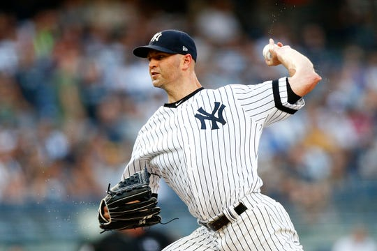 Jul 19, 2019; Bronx, NY, USA; New York Yankees pitcher J.A. Happ (34) pitches against the Colorado Rockies during the first inning at Yankee Stadium.