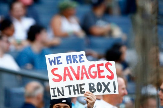 Jul 19, 2019; Bronx, NY, USA; A fan holds up a sign prior to the Colorado Rockies taking on the New York Yankees at Yankee Stadium.