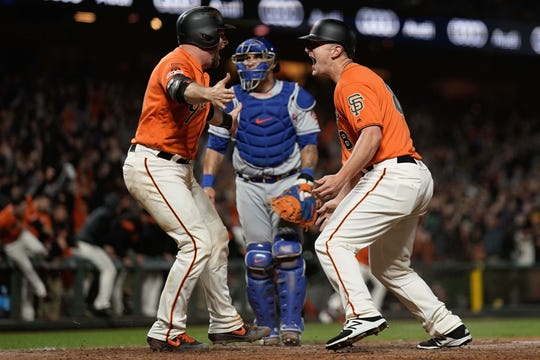 Jul 19, 2019; San Francisco, CA, USA; San Francisco Giants left fielder Alex Dickerson (8) celebrates with catcher Stephen Vogt (21) after scoring the winning run against the New York Mets at Oracle Park.