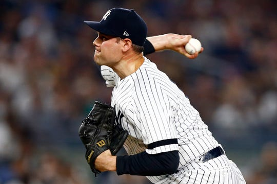 Jul 19, 2019; Bronx, NY, USA; New York Yankees pitcher Adam Ottavino (0) pitches against the Colorado Rockies during the sixth inning at Yankee Stadium.