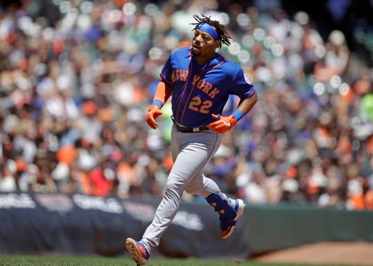 New York Mets' Dominic Smith runs the bases after hitting a home run off San Francisco Giants' Jeff Samardzija in the second inning of a baseball game Saturday, July 20, 2019, in San Francisco. (AP Photo/Ben Margot)