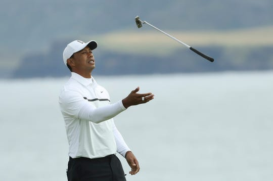 Tiger Woods of the United States throws his club in the air con the 5th green during the second round of the British Open Golf Championships at Royal Portrush in Northern Ireland, Friday, July 19, 2019.