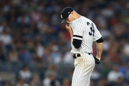 J.A. Happ #34 of the New York Yankees reacts in the fourth inning against the Colorado Rockies at Yankee Stadium on July 19, 2019 in New York City.