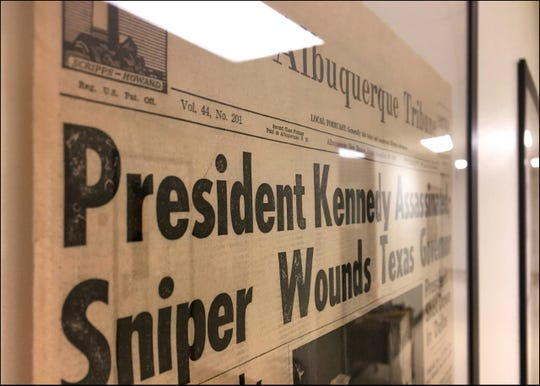 The Nov. 22, 1963, edition of the Albuquerque Tribune bears news of President Kennedy's assassination. The newspaper is one of several historic page fronts now on display in the NMSU Department of Journalism and Media Studies.