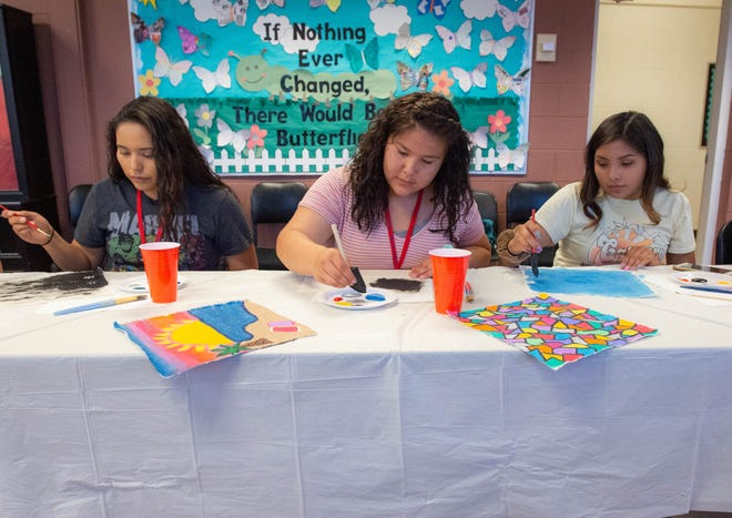 High School students in the Dream Keepers summer program paint on to fabrics in a seminar about textiles at Gerald Thomas Hall Tuesday, June 20, 2019 at New Mexico State University.