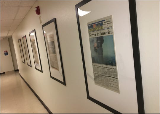 Historic newspaper page fronts appear on permanent display in a Milton Hall corridor. The newspapers were a gift from NMSU employee Carol Meyers to the Department of Journalism and Media Studies.