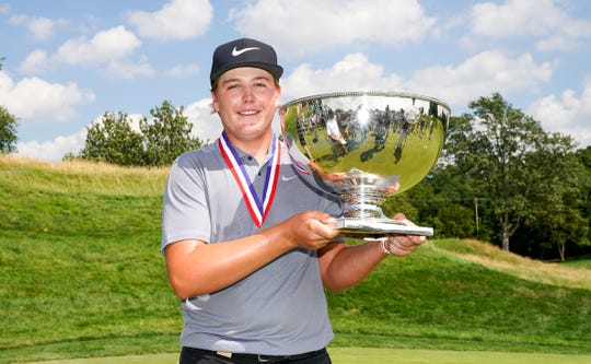 Preston Summerhays holds the trophy after winning on the 35th hole during the finals at the 2019 U.S. Junior Amateur at Inverness Club in Toledo, Ohio on Saturday, July 20, 2019.