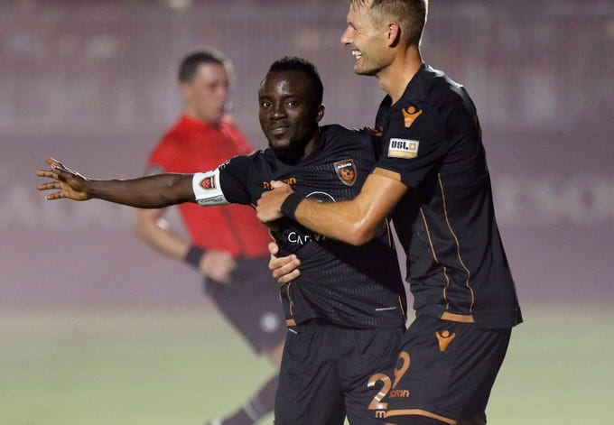 Phoenix Rising's Solomon Asante (20) celebrates their third goal against Austin Bold with teammate Adam Jahn (9) during the second half at Casino Arizona Field in Scottsdale July 19, 2019. (Darryl Webb/For the Republic)