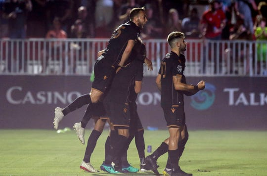 Phoenix Rising players celebrate towards their fans after their third goal against Austin Bold during the second half at Casino Arizona Field in Scottsdale July 19, 2019. (Darryl Webb/For the Republic)
