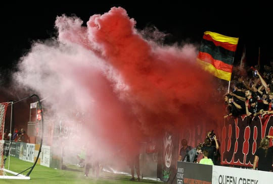 Phoenix Rising fans let off a smoke bomb after the Rising scored their third goal against Austin Bold during the second half at Casino Arizona Field in Scottsdale July 19, 2019. (Darryl Webb/For the Republic)
