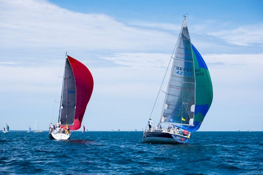 The Mistress Quickly, right, gains on the Pirate as they compete in the 2019 Bell's Beer Bayview Mackinac Race Saturday, July 20, 2019, on Lake Huron.