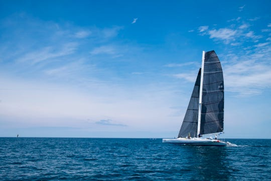 The multihull Earth Voyager pulls away from the rest of the pack at the start of the Port Huron-to-Mackinac race Saturday, July 20, 2019, on Lake Huron.