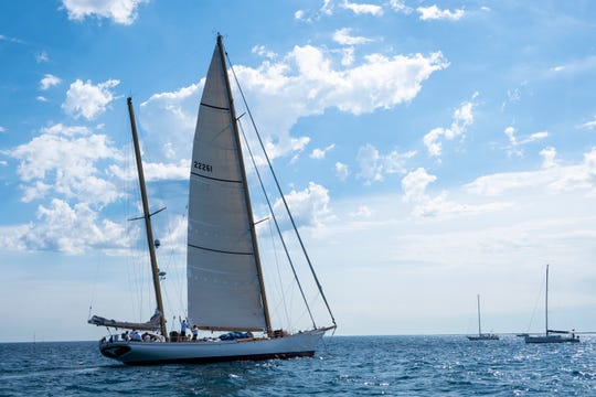 The 105-foot Whitehawk circles the starting line in the 2019 Bell's Beer Bayview Mackinac Race Saturday, July 20, 2019, on Lake Huron. The Whitehawk is the largest ship to ever compete in the race.