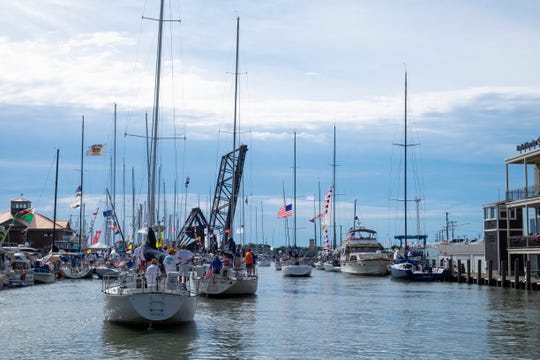 Boats head toward Lake Huron on the Black River Saturday, July 20, 2019, before the Port Huron-to-Mackinac Race.