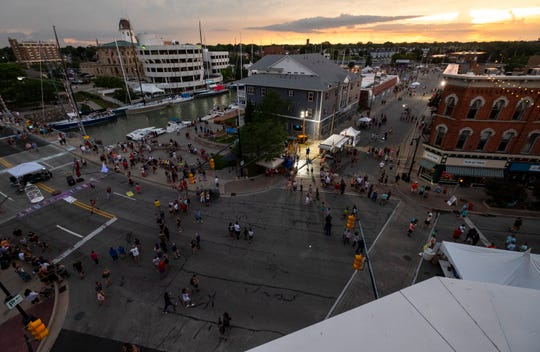 People hang out at the intersection of Quay Street and Huron Avenue on Boat Night, Friday, July 19, 2019, in Port Huron.