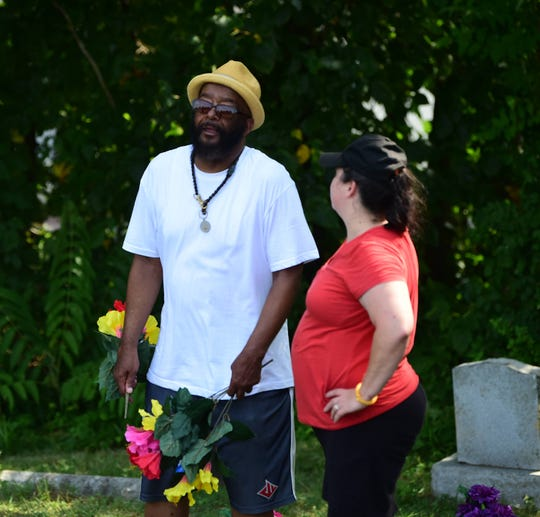 Wayne Scott Sr. talks with a volunteer at Lebanon Cemetery in North York on Saturday, July, 20.