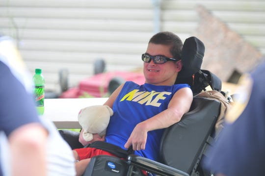 Jeremiah Lehman smiles as a group of law enforcement officers visits him Saturday, July 20, 2019, at his Hagerstown home.