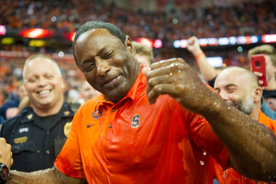 Syracuse Orange head coach Dino Babers gets dunked with the water cooler after the Orange defeated Clemson on Oct. 13, 2017 Clemson has not lost a regular-season game since and returns to Syracuse on Saturday.