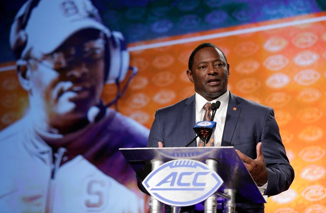 Syracuse head coach Dino Babers speaks to the media during the Atlantic Coast Conference NCAA college football media day in Charlotte, N.C., Thursday, July 13, 2017.