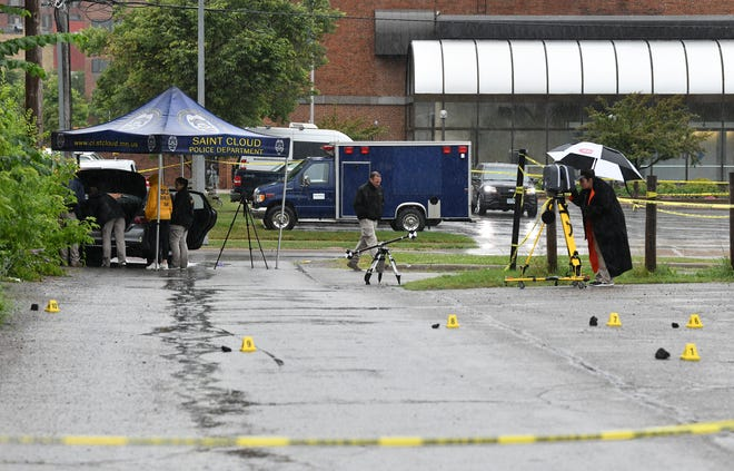 Investigators record items at a crime scene in the alley in the 300 block between Fourth Avenue South and Fifth Avenue South Saturday, July 20, 2019, in St. Cloud.
