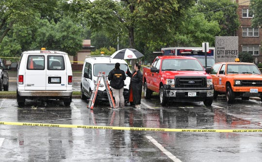 Investigators examine vehicles in the St. Cloud City Hall parking lot as part of a crime scene Saturday, July 20, 2019, in St. Cloud.