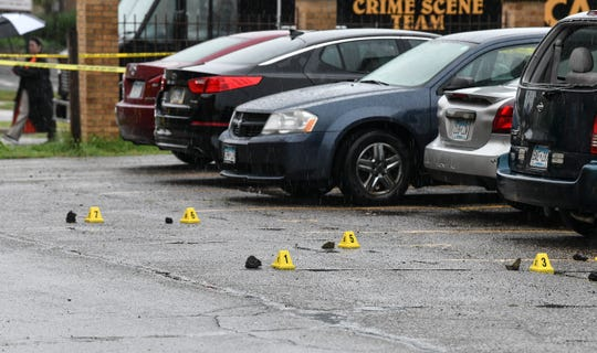 Evidence markers are placed near items in the alley in the 300 block between Fourth Avenue South and Fifth Avenue South Saturday, July 20, 2019, in St. Cloud.