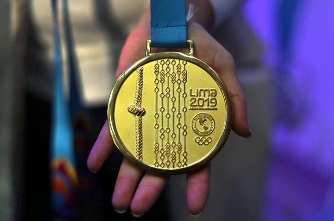 A Pan American Games gold medal is shown during a media presentation, in Lima, Peru, Thursday, July 11, 2019. The Pan American Games begin July 26 and run through Aug. 11, 2019, in Lima. (AP Photo/Martin Mejia)