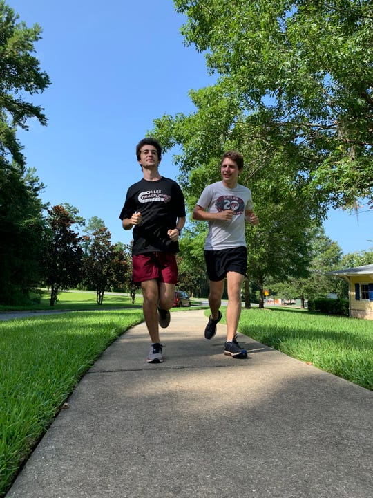 Spencer Amsellem, left, and John Cruz Yearty are running this summer to help raises money to fight bullying.
