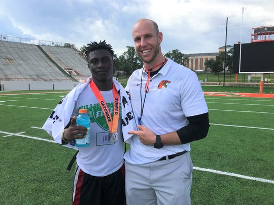 Jeremiah Fergerson of American Collegiate Academy in Clearwater won the Gatorade Award as the top player during the Willie Simmons Elite Prospect Camp II. He received his prize from FAMU running backs coach/camp coordinator Joseph Henry.