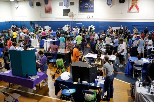 The Griffin Middle School gymnasium bustling with Griffin Heights community members for the Community Day and Public Safety Fair Saturday, July 20, 2019.