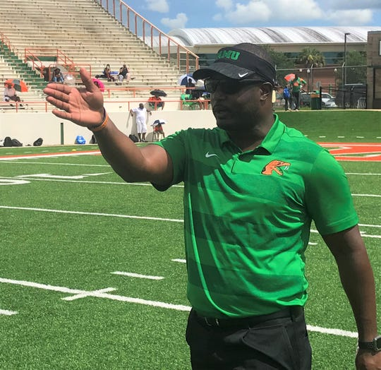 FAMU football head coach Willie Simmons gives out instructions during his elite prospect camp.