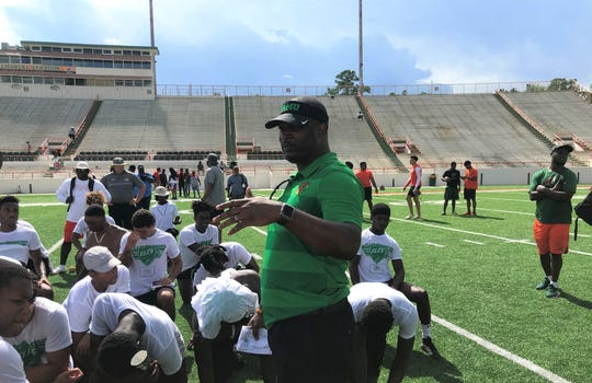 FAMU football head coach Willie Simmons talks with high school players following the conclusion of the Willie Simmons Elite Prospect Camp II on Saturday, July 20, 2019.