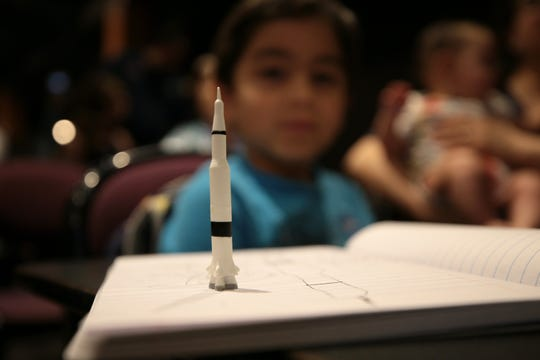 "A child attends El Pasoan and former NASA astronaut Danny Olivas' appearance on a panel Friday, July 19, 2019, at the UTEP Union Cinema. Olivas also introduced the ""Apollo 11"" 50th anniversary documentary."
