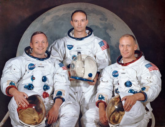 """This March 30, 1969, photo made available by NASA shows the crew of the Apollo 11, from left, Neil Armstrong, commander; Michael Collins, module pilot; Edwin E. """"Buzz"""" Aldrin, lunar module pilot. Apollo 11 was the first manned mission to the surface of the moon."""