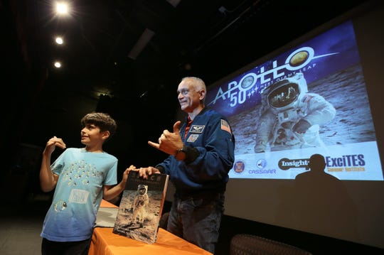 "UTEP alumnus and former NASA astronaut Danny Olivas introduced the documentary ""Apollo 11"" on Friday, July 19, 2019, at the UTEP Union Cinema.  Enzo Manning, 11, takes a photo with Olivas after getting Olivas' autograph in his space book."